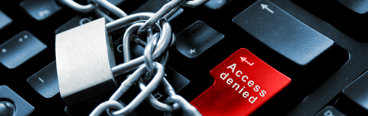 An image representing internet and computer security. The image showing a keyboard, a red 'Access Denied' button and a lock and chain